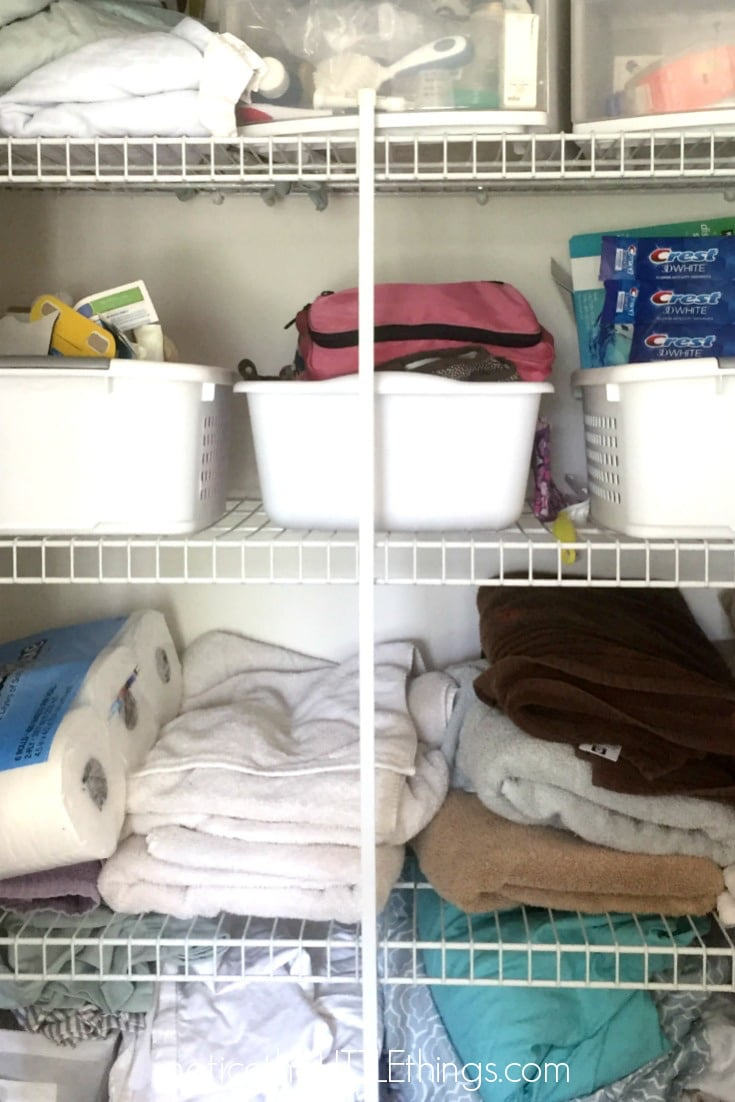 organized linen closet before picture